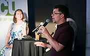 """Managing Editor Chris Murphy gives introduces the """"Corner Table Podcast"""" during the live taping at Old Sugar Distillery in Madison, Wisconsin, Tuesday, June 18, 2019."""