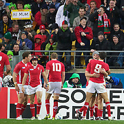 Jonathan Davies, Wales, is congratulated by Mike Phillips after scoring a try during the Ireland V Wales Quarter Final match at the IRB Rugby World Cup tournament. Wellington Regional Stadium, Wellington, New Zealand, 8th October 2011. Photo Tim Clayton...