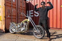 "Ryan Grossman with his Vintage Dreams ""Badd Hunny"" 1954 Harley-Davidson Panhead at the docks on setup day for the 27th Annual Mooneyes Yokohama Hot Rod Custom Show 2018. Yokohama, Japan. Saturday, December 1, 2018. Photography ©2018 Michael Lichter."