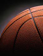 Close up dramatically lit detail photo of a basketball