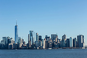 Liberty Island, NY - 9 January 2020. The southern end of Manhattan, with One World Trade Center, seen from of Liberty Island..