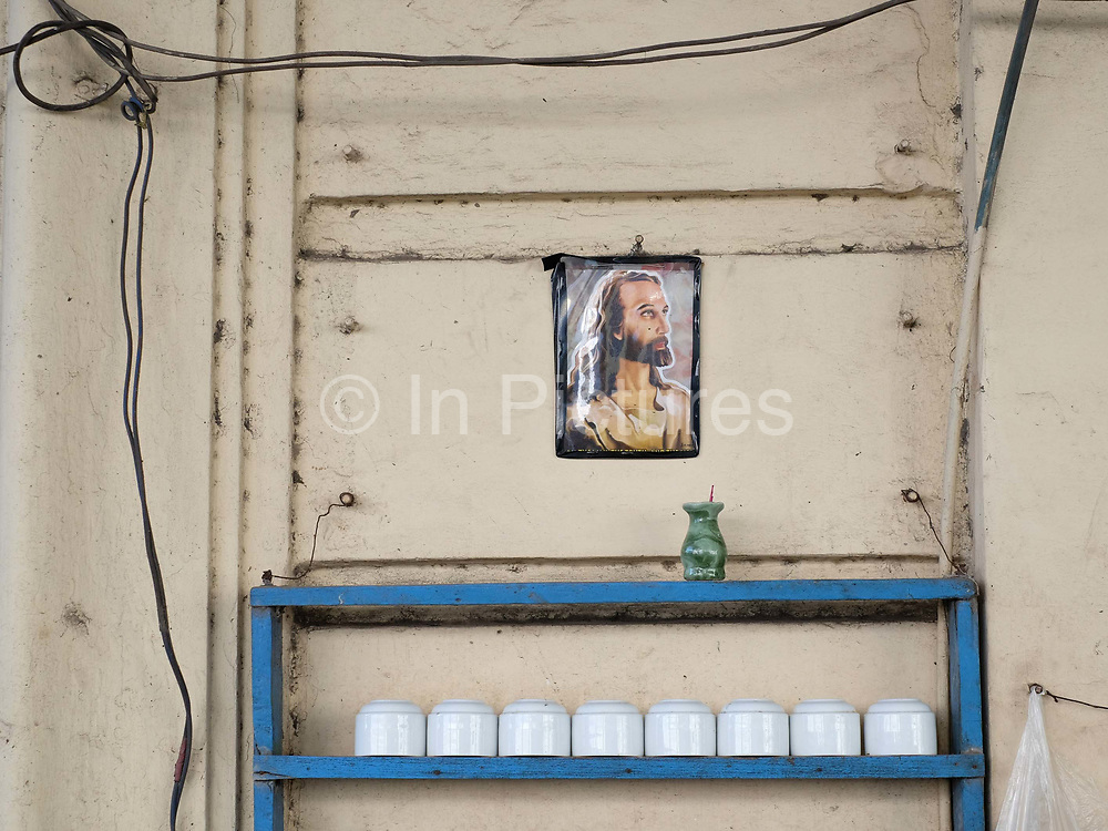 Portrait of Jesus at a tea shop on the streets of Yangon, Myanmar on 5th November 2016
