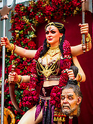 19 OCTOBER 2018 - BANGKOK, THAILAND: A Navratri altar with the feminine Devi holding the head of a vanquished male enemy during Navratri celebrations in Bangkok. Navratri is a nine night (10 day) long Hindu celebration that marks the end of the monsoon and honors of the divine feminine Devi (Durga). The festival is celebrated differently in different parts of India, but the common theme is the battle and victory of Good over Evil based on a regionally famous epic or legend such as the Ramayana or the Devi Mahatmya. Navratri is celebrated throughout Southeast Asia in communities that have a large Hindu population.  PHOTO BY JACK KURTZ