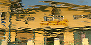 Building reflection in water at Maha Wizaya, Pagoda, Yangon