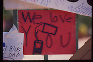 The OJ Simpson trial and media circus.<br /> A sign left on OJ Simpson's Brentwood home front gate.
