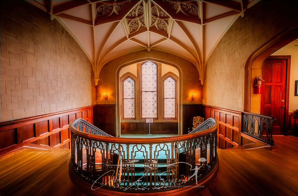 A staircase leads to the ground floor of Callanwolde Fine Arts Center and offers visitors a glimpse of the intricately-crafted Aerolian organ rib vault on the ceiling. Callanwolde is housed within a 27,000 square foot Gothic-Tudor Revival mansion and nestled on 12 acres in Atlanta, Georgia. The house, built in 1920, was the home of Charles Howard Candler, son of the founder of the Coca-Cola Company. The house was designed by architect Henry Hornbostel. Today, Callanwolde operates as a non-profit organization devoted to teaching and promoting the visual, literary and performing arts. (Photo by Carmen K. Sisson/Cloudybright)