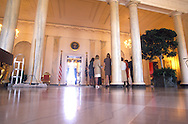 IN THE GRAND FOYER, SOCIAL AIDES RECEIVE THEIR BRIEFING ON THE DETAILS OF THE STATE DINNER.