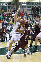 15 December 2012: Parker Musselman moves in to stop the progression of Royce Muskeyvalley during an NCAA mens division 3 basketball game between theUniversity of Chicago Maroons and the Illinois Wesleyan Titans in Shirk Center, Bloomington IL