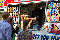 2015-06-18 UK Weather: City workers enjoy the lunchtime sunshine with ice creams.