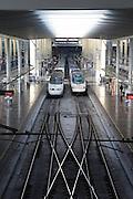 Two RENFE Alvia trains at platform of Atocha railway station, Madrid, Spain