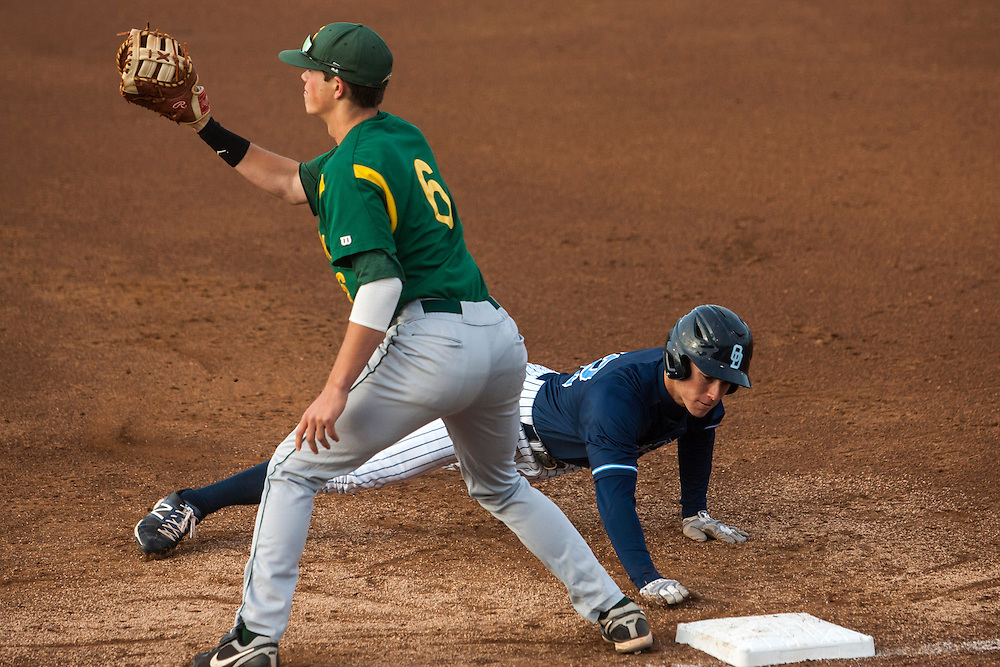 May 3, 2013; Norfolk, VA; ODU Monarchs right fielder Ben Verlander (32) dives back to first base as George Mason Patriots first baseman Mick Foley (6) fields a throw at the Bud Metheny Baseball Complex . Mandatory Credit: Peter Casey-USA TODAY Sports