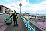 A community public space cleaner pose in front of camera as he clears the walking pathway along the Brighton Beach on Sunday, April 11, 2021. <br /> On Monday, April 12, England enters the next stage of government's roadmap out of lockdown, when the non-essential shops, outdoor hospitality, and personal services including hairdressing can open again. (Photo/ Vudi Xhymshiti)