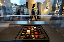 BRUSSELS, BELGIUM  -  In a neighborhood otherwise given to art and antique galleries, Pierre MarcoliniÕs store, with its lean furnishings and black glass topped cabinets resembles more a Tiffany jewelry store than a chocolate shop. His chocolates, with their tiny gold lettering or gold filament decorations, evoke more microchips than Mars bars. (Photo © Jock Fistick)
