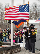 Goshen, New York -The Orange County Sheriff's Office honor guard takes part in a Wreaths Across America ceremony at Orange County Veterans Memorial Cemetery on Dec. 16, 2017. About 3,000 wreaths were placed at graves, and small American flags were added to the wreaths at veterans' graves.