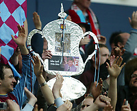 Photo: Chris Ratcliffe.<br /> Middlesbrough v West Ham United. The FA Cup, Semi-Final. 23/04/2006.<br /> West Ham fans celebrate going through and pay tribute to the last man to take them to an FA Cup Final, John Lyall who died last week