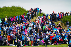 Auchterarder, Scotland, UK. 14 September 2019. Saturday morning Foresomes matches  at 2019 Solheim Cup on Centenary Course at Gleneagles. Pictured; Crowds of spectators on hill beside the 9th green.  Iain Masterton/Alamy Live News