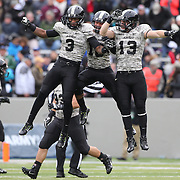 Quarterback Angel Santiago, (left), Army, is congratulated by team mates after a successful play during the Army Black Knights Vs Air Force Falcons, College Football match at Michie Stadium, West Point. New York. Air Force won the game 23-6. West Point, New York, USA. 1st November 2014. Photo Tim Clayton