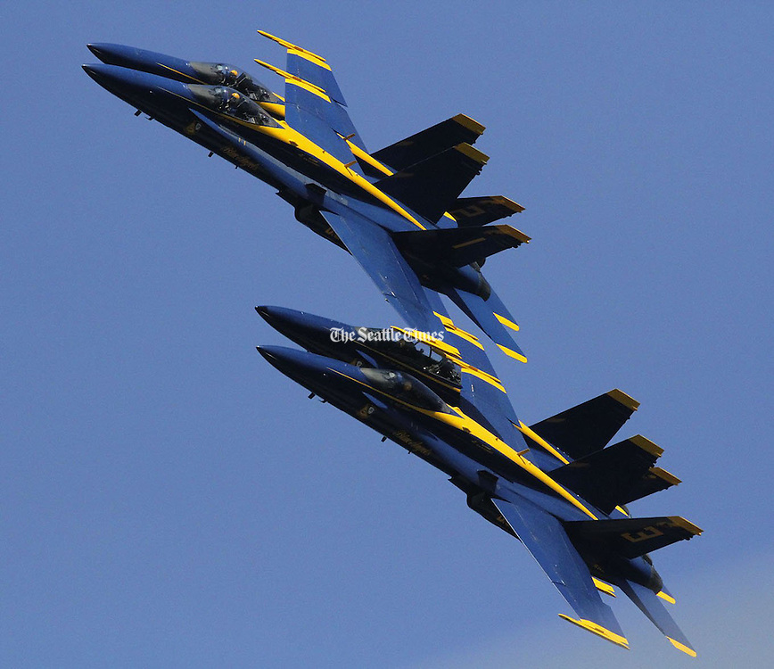 Separated by more than a few feet, the US Navy Blue Angels fly in tight formation. (Greg Gilbert / The Seattle Times)