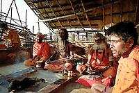 Hindu holy men Chanting at the ghats in Varanasi, Uttar Pradesh, India