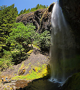 Hikers relax below Wy'East Falls, a short side trip along the Eagle Creek Trail, in Columbia River Gorge National Scenic Area, Oregon.