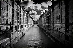 View of canal in Speicherstadt historic warehouse district in Hamburg Germany