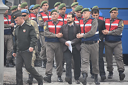People, mainly Turkish soldiers, accused of trying to assassinate Turkish President during the July coup attempt, are escorted by security forces towards the courthouse in Mugla, western Turkey, on February 20, 2017. The trial opened on February 20, of almost 50 suspects accused of plotting to assassinate President Recep at a luxury Aegean hotel on the night of the botched July 15 coup. Photo by Depo Photos/ABACAPRESS.COM