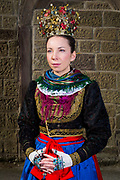 Nadine, member of the Verein für Heimat- und Brauchtumspflege Geldersheim e.V., is wearing an original traditional bridal costume from 1850 in Geldersheim, Upper Franconia in Germany on March 4th, 2017.<br /> <br /> The jewelry is in private ownership of the families, the dress and crown are owned by the association.<br /> <br /> This is a Werntaler tradtional costume from Geldersheim.<br /> <br /> This is part of the series about Traditional Wedding Gowns from different regions of Germany, worn by young members of local dance groups and cultural associations that exist to preserve and celebrate the cultural heritage. The portraiture series is a depiction of an old era with different social values and religious beliefs in an antiquated civil society with very few of those dresses left.