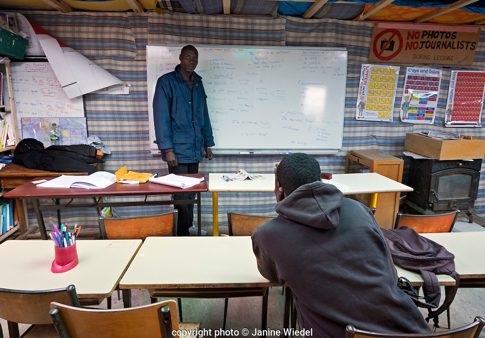 JeJe from Republic of Central Africa School in The Calais Jungle open daily and teaching English and French to refugees and migrants living in the camp