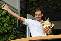 Tennis - 2017 Wimbledon Championships - Week Two, Sunday [Day Thirteen]<br /> <br /> Men Doubles Final match<br /> <br /> Marin Cilic (CRO) vs Rodger Federer (SUI)<br /> <br /> Rodger Federer shows off the trophy to the fans outside Centre court , from the Balcony <br /> <br /> COLORSPORT/ANDREW COWIE