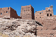 Stork Kasbah with storks in Ouarzazate (Kasbah des Cigognes) against clear blue sky.