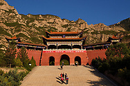 People walking at the Entrance gate to the Beiyue Hengshan Mountain National Park, Datong, Hunyuan County, Shanxi Province, China
