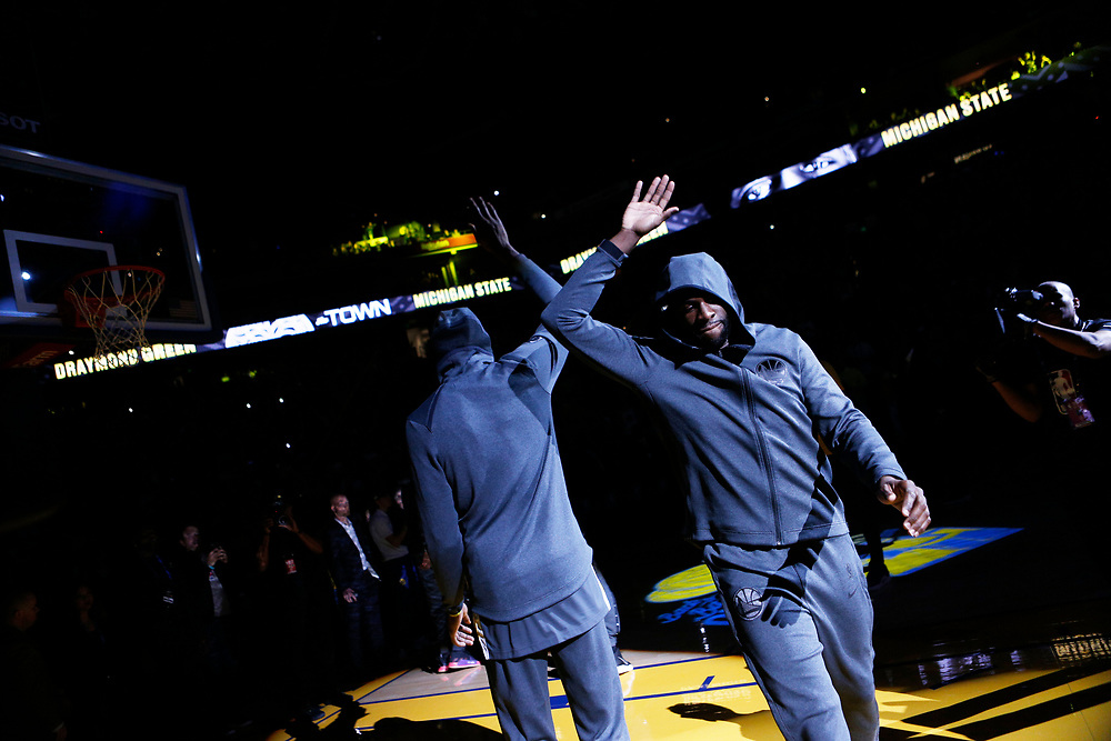 Golden State Warriors forward Draymond Green (right) high fives Kevin Durant (35) before an NBA game against the Los Angeles Lakers at Oracle Arena on Saturday, Feb. 2, 2019, in Oakland, Calif. The Warriors won 115-101.