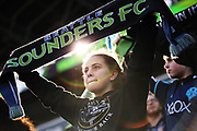 Fans hold up their scarves before the Sounders season opener against New York, Sunday, March 19, 2017 at CenturyLink Field. (Genna Martin, seattlepi.com)