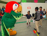 The Fiesta mascot greets students during the Hilliard Fall Festival, October 24, 2013. Free shoes were distributed to all the students and parents were able to sign up for services and receive books and backpacks for their children.