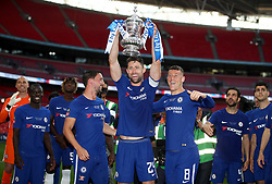 Chelsea's Gary Cahill (centre) and his team-mates celebrate with the FA Cup trophy