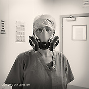 Throughout the Covid pandemic here in the UK, there has been a huge shortage of PPE but conversely, a huge increase in the demand for single use plastic. Here in Ysbyty Gwynedd in North Wales, there has for a few years been a drive to increase the use of greener practices. These full face masks are re-usable and it seems there are now plans to use these in everyday day theatre even after the Covid pandemic is (hopefully) over.    <br /> <br /> <br /> From my exhibition series for  Betsi Cadwaladr via the Betsi Research Unit.<br /> <br /> My brief was not frontline action as seen on all news outlets, but the way hospitals & staff have adapted to cope with the crisis, from PPE to social distancing & also those vital behind the frontline workers essential throughout the crisis to support frontline NHS staff.<br />  <br /> A small touring exhibition will be open to the public when safer times permit.