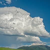 Summer thunderheads build over a farm in the southern Gallatin Valley near Bozeman, Montana.