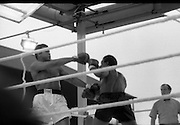 Ali vs Lewis Fight, Croke Park,Dublin..1972..19.07.1972..07.19.1972..19th July 1972..As part of his built up for a World Championship attempt against the current champion, 'Smokin' Joe Frazier,Muhammad Ali fought Al 'Blue' Lewis at Croke Park,Dublin,Ireland. Muhammad Ali won the fight with a TKO when the fight was stopped in the eleventh round...Ali backs up parrying the blows from Lewis.