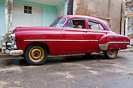 Old red American car in Gibara, Holguin, Cuba.