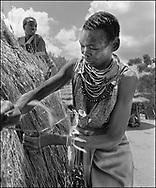Karamajong women building a traditional raised thetched grain store- Karamajong Uganda 1980