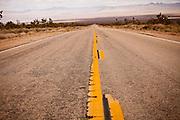 Stretch of empty road through the Mojave Desert in the Mojave National Preserve, San Bernardino, CA