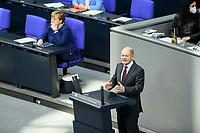 08 DEC 2020, BERLIN/GERMANY:<br /> Angela Merkel (L), CDU, Bundeskanzlerin, und Olaf Scholz, MdB, SPD, Bundesfinanzminister, Haushaltsdebatte, Plenum, Reichstagsgebaeude, Deuscher Bundestag<br /> IMAGE: 20201208-02-037<br /> KEYWORDS: Rede