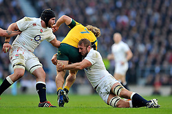 England captain Chris Robshaw tackles Australia captain Michael Hooper - Photo mandatory by-line: Patrick Khachfe/JMP - Mobile: 07966 386802 29/11/2014 - SPORT - RUGBY UNION - London - Twickenham Stadium - England v Australia - QBE Internationals
