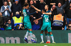 Tottenham Hotspur's Harry Kane (right) celebrates scoring his side's first goal of the game with team-mates