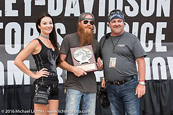 Jack McIntyre gives out an award at the Harley-Davidson Editors Choice Custom Bike Show during the annual Sturgis Black Hills Motorcycle Rally. SD, USA. August 9, 2016. Photography ©2016 Michael Lichter.