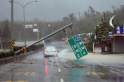 PINGTUNG, Sept. 14, 2016 (Xinhua) -- A road sign is broken by strong wind on a highway from Pingtung to Kenting in typhoon-hit Taiwan, southeast China, Sept. 14, 2016. Typhoon Meranti on Wednesday brought strong winds and heavy downpour to the island. (Xinhua) (ry) (Credit Image: © Johnson Liu/Xinhua via ZUMA Wire)
