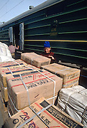 Workers unload cargo from the Trans-Siberian railroad during a stop in Khabarovsk, Russia.