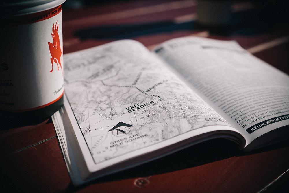 Mountain biking guidebook for Alaska during morning coffee.