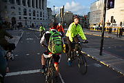 Commuters cycling in London, England, United Kingdom. Cycling has become a very popular mode of transport in the capital as people try to avoid public transport, saving money, getting fit and saving time.
