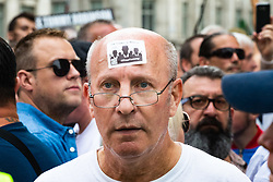 """A man has an """"I'm Tommy Robinson"""" sticker attached to his forehead as several hundred protesters in central London demand the release of """"political prisoner"""" right wing talisman Stephen Yaxley-Lennon  - also known as Tommy Robinson, who was imprisoned for contempt of court. London, August 03 2019."""